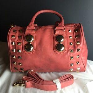 Gently used Handbag with gold hardware design