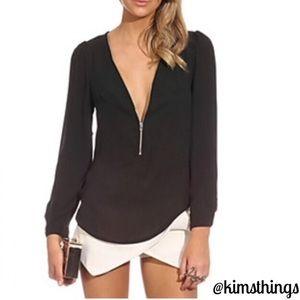 Black front half zip long sleeve top/runs small