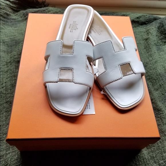 a33c2677a980  sold NIB Hermes oran H sandals white 37 US7