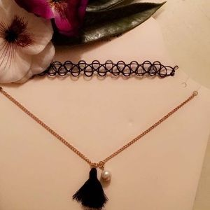 Tattoo choker and pearl necklace.