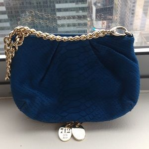 Henri Bendel royal blue clutch and wristlet