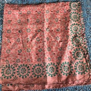 Hand woven and printed silk scarf.