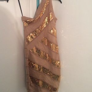 One shoulder gold sequin and nude dress