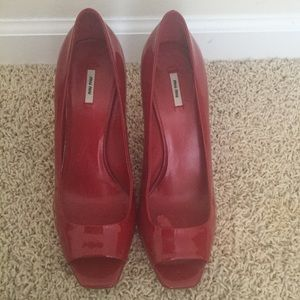 Women's Miu Miu red patent leather pumps
