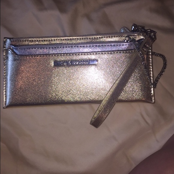 9898e798e30 Gold and silver Steve madden clutch wallet.