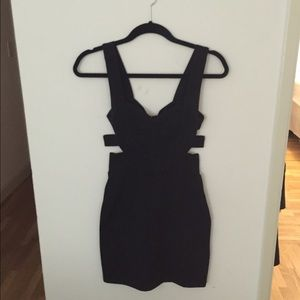 Zinga Dresses & Skirts - SM blk dress w/ sweetheart top & cut outs on sides