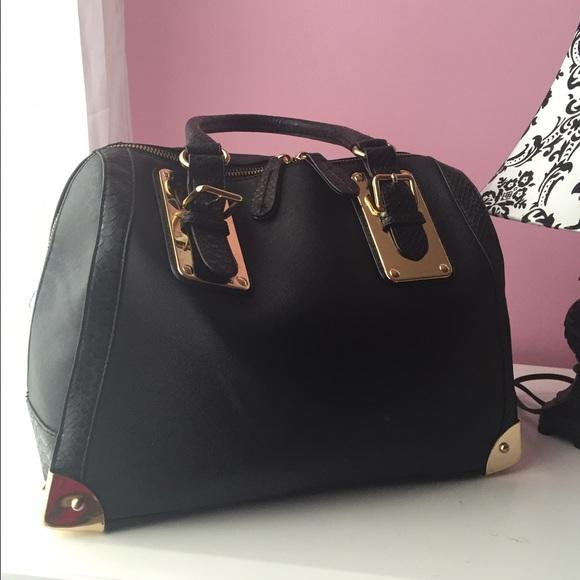 80c4efe936f ALDO Handbags - ALDO Black   Gold Purse