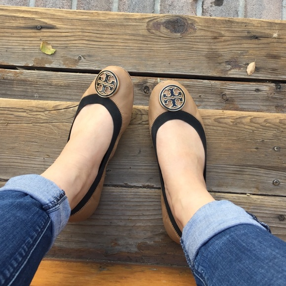 Tory Burch cream flats with a black outline