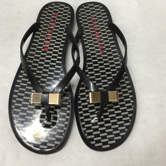 0ac5a1bd10ddb0 Coach Shoes - Coach black and white gold bow jelly flip flops