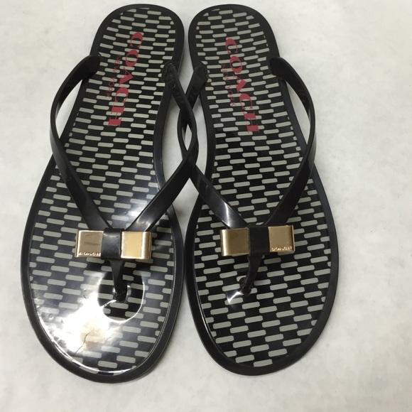 2f3b00da1db556 Coach Shoes - Coach black and white gold bow jelly flip flops