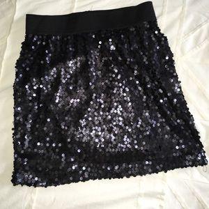 Black sequin mini skirt.