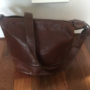 Brown leather cross body satchel.