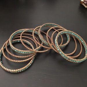 Teal and gold bangles, bracelets.