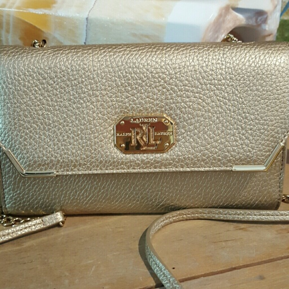 cf6afef942 NWOT Ralph Lauren gold clutch with strap. M 5741ff15bf6df5f5060591dd