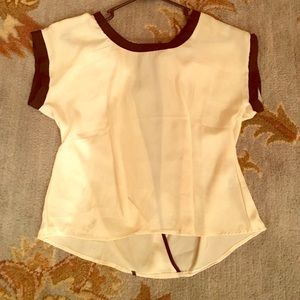 Cream silk shirt with open back and silk bow