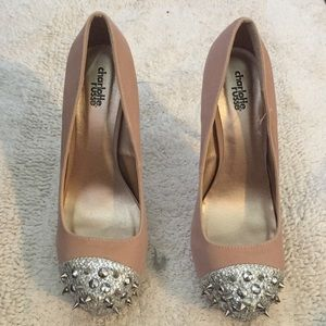 Spiked toe nude pumps