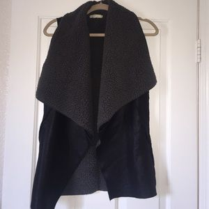 Faux leather and fur vest