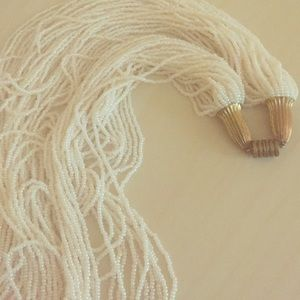 Long cream beaded statement necklace