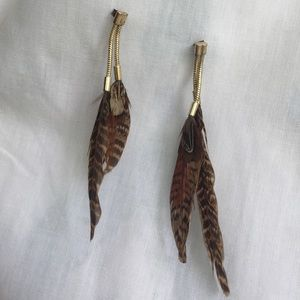 Feather and gold earrings