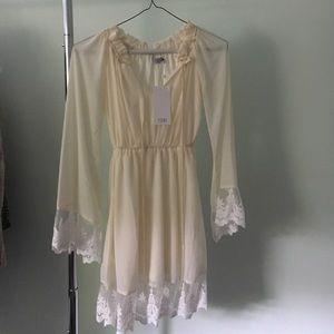 Tobi cream dress.
