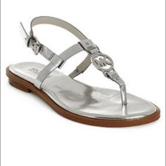 13c86698367 Michael Kors silver flat sandals. M 57451a4b7f0a0597b70101c4