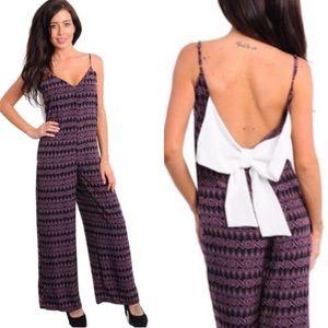 Boutique Pants - 🎉CLEARANCE🎉 Purple & Black Strappy Bow Jumpsuit