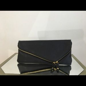 Urban Expressions black clutch with gold zipper