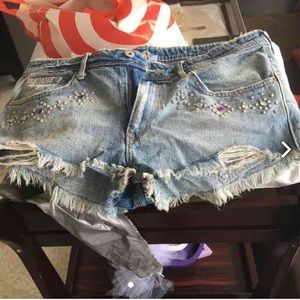 Pants - Denim distressed shorts pair them with cute boots