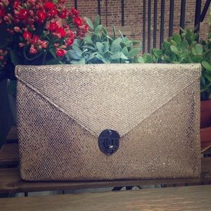 Gold envelope style clutch