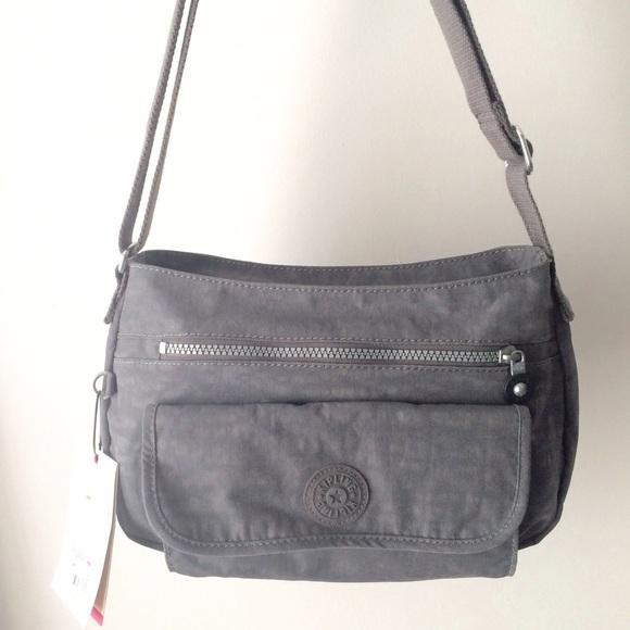 a5595cc6405 Kipling Bags | Syro Crossbody Bag Dusty Grey | Poshmark