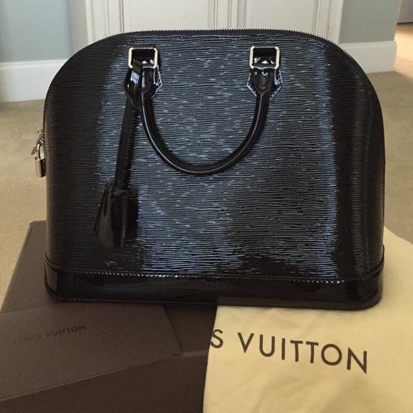 ea21107b1b2 Louis Vuitton Handbags - Louis Vuitton alma mm epi electric
