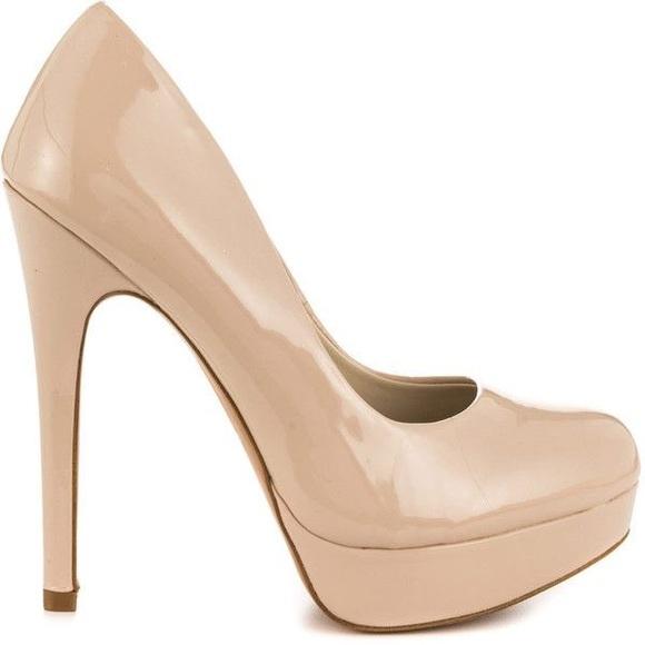 85% off ALDO Shoes - Aldo Tan & cream high heels from Ahmad's ...