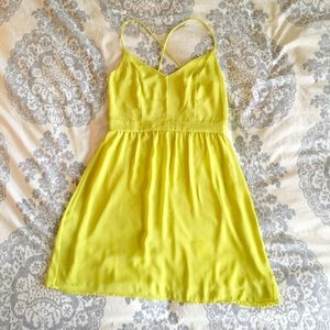 Adorable neon yellow dress with cutout back
