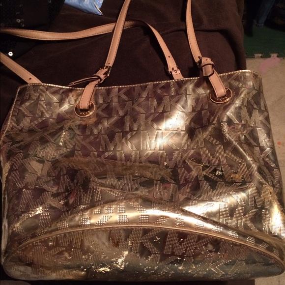 Michael Kors Bags - Iu0027m selling a used metallic gold MK purse.