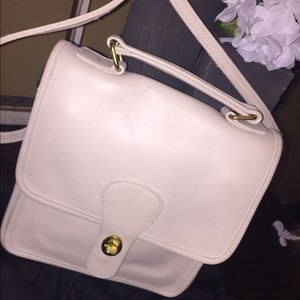 Cream colored leather messenger bag