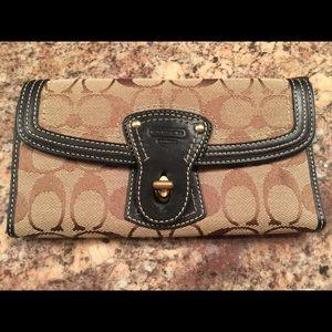 COACH...AUTHENTIC signature wallet.