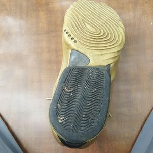 Gold nike carbon basket ball shoe 11