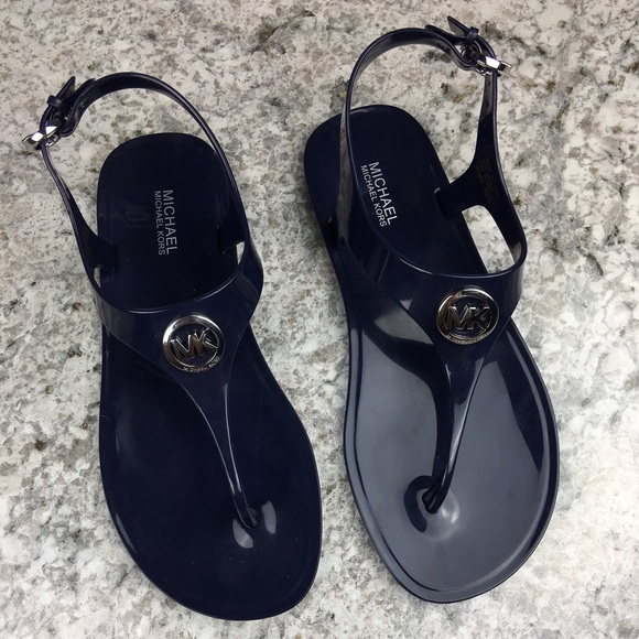 745f31b4a4ba Michael Kors navy blue jelly logo t strap sandals