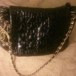 Women s Chanel Puzzle Bag on Poshmark a52ba5b962
