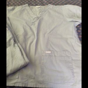 4 sets of solid color preowned scrub top and pants