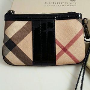 09a202220fb2 Burberry Bags - Sale! Burberry Nova Wristlet