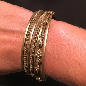 Gold tone bangles by The limited