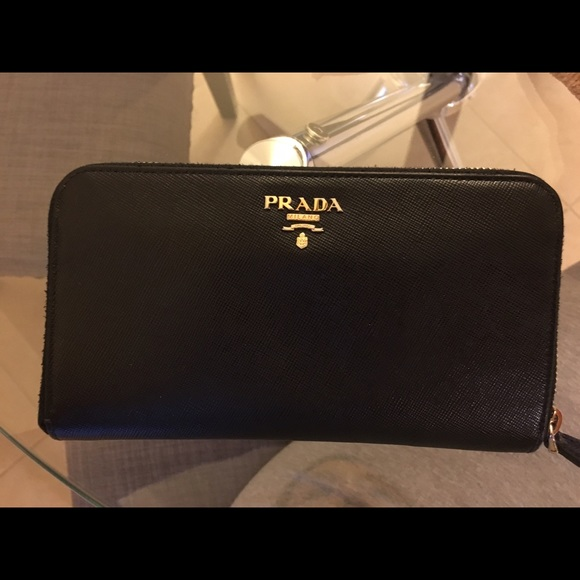 a3a59ec4a419 Prada saffiano long zippy wallet black authentic. M_5757663bea3f36b9120106ee