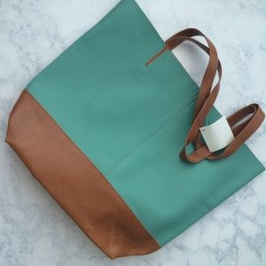 Handbags - Leather-like two tone tote.