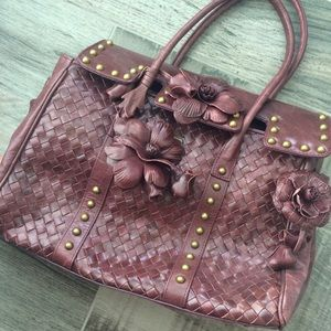 Woven wine colored floral handbag