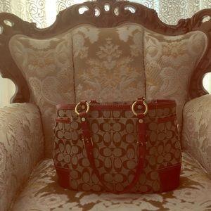 Red trim original coach print purse
