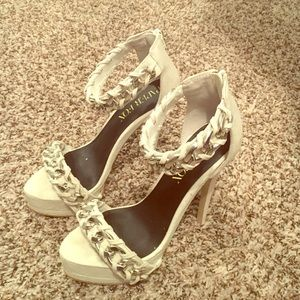 White stiletto heels with a small platform