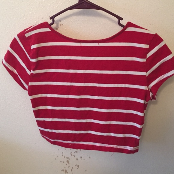 This trendy top is sure to please with its slightly vibrant red stretch knit construction, classic white striped pattern, unique square neckline, long sleeves, and fitted .