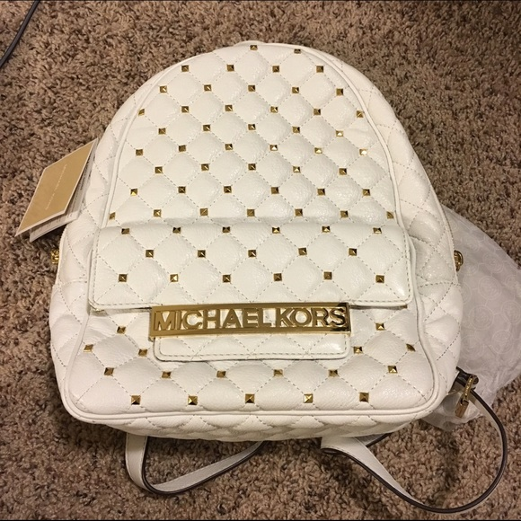 38b3f409c8d261 Michael kors white quilted studded gold backpack. M_575ccbb041b4e0b7df009db6
