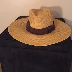 Floppy straw hat.